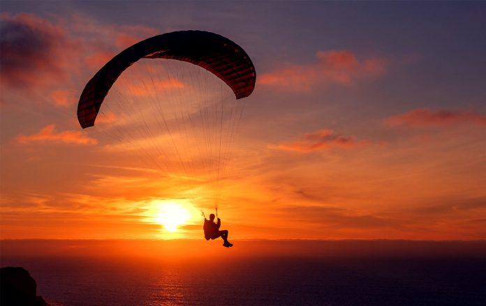 paraglider infront of sunset